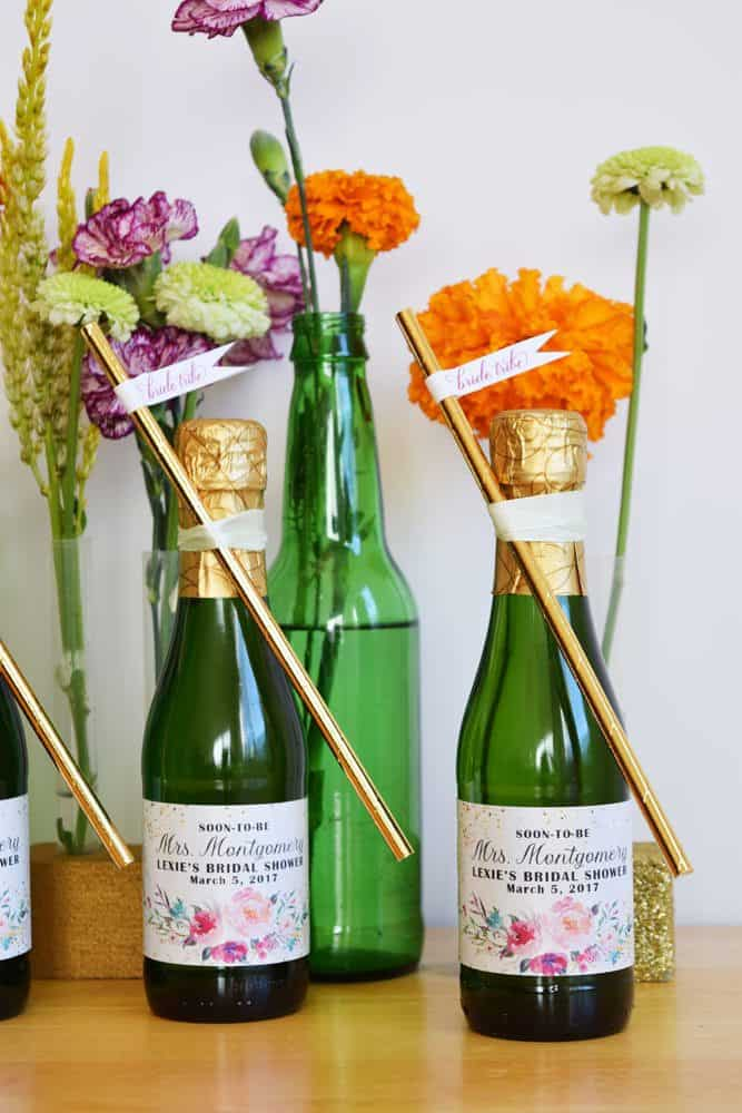 867d779f2d8 We love this boho chic bridal shower table top decoration idea. We used our  DIY test tube flower vases and recycled soda bottles that we cleaned.