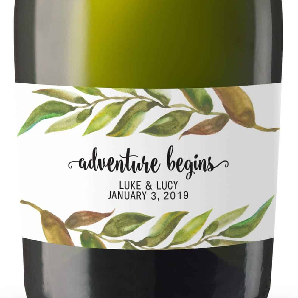 "Mini Champagne Bottle Label Sticker ""Adventure Begins"" by LoveAtEverySight"